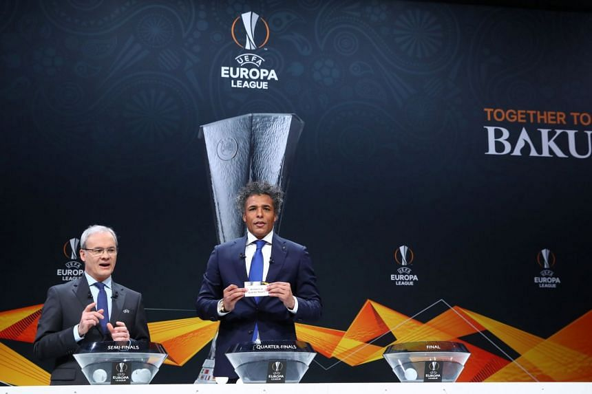 Uefa competitions director Giorgio Marchetti and Uefa Europa League ambassador Pierre van Hooijdonk during the semi-final draw in Nyon Switzerland