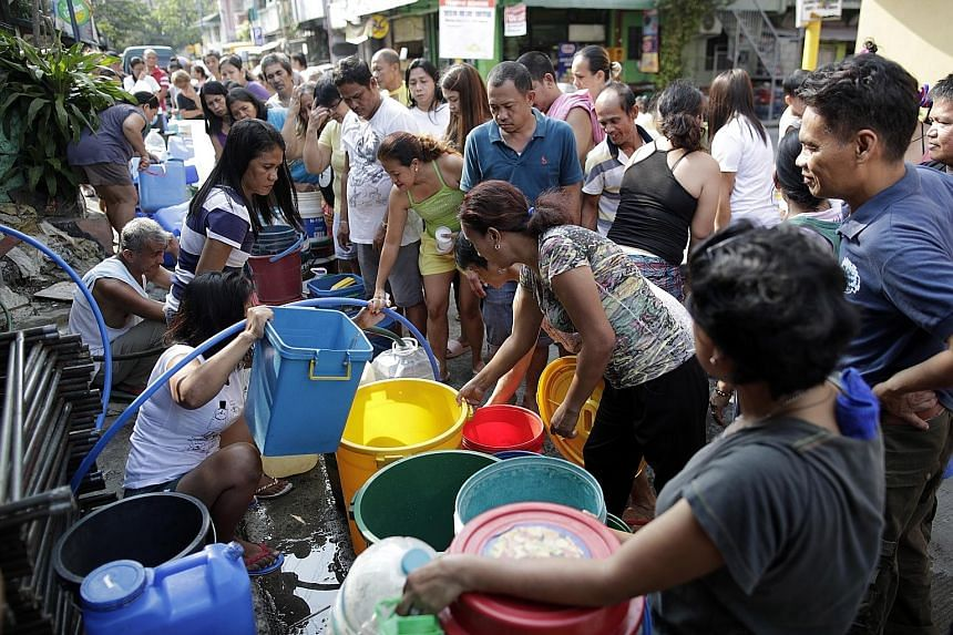 Waiting to fill buckets at a water distribution point in Mandaluyong city, east of Manila, on Wednesday. Manila Water, which supplies half of the capital region, said the situation will return to normal when the rains come.