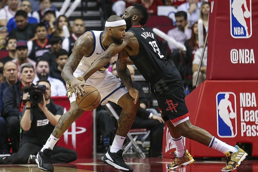 Houston guard James Harden attempting to steal the ball from Golden State centre DeMarcus Cousins in the fourth quarter at Toyota Centre.