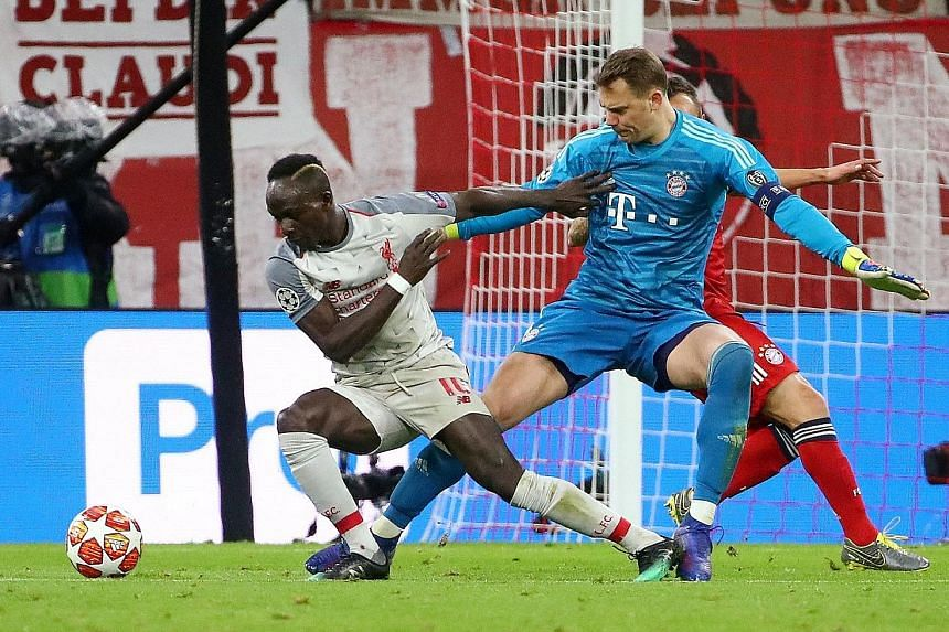 Poetry in motion as Sadio Mane evades Bayern goalkeeper Manuel Neuer's challenge before netting the opening goal. The Senegalese is now Liverpool's highest away scorer in the tournament, one ahead of the six goals each by Steven Gerrard and Roberto F