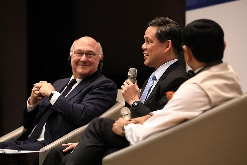 Trade and Industry Minister Chan Chun Sing speaking at the Singapore-France Economic Forum. With him are former French minister Michel Sapin and moderator Nitin Jaiswal from Bloomberg.