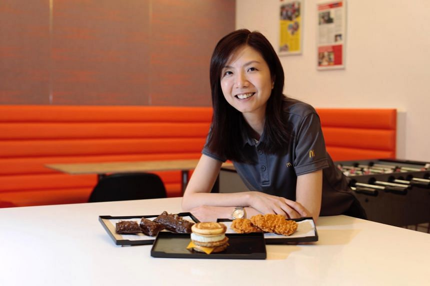 Ms Nita Chan, director of supply chain, menu management and quality assurance, with McDonald's new food items.