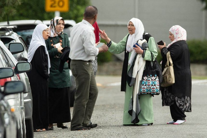 Members of a family react outside the mosque following a shooting at the Al Noor mosque in Christchurch, New Zealand, on March 15, 2019.