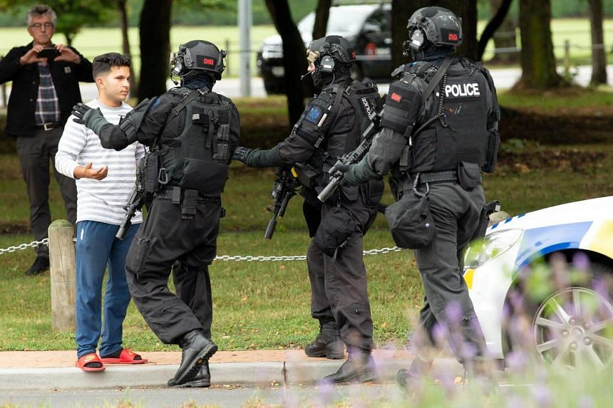 AOS (Armed Offenders Squad) push back members of the public following a shooting at the Al Noor mosque in Christchurch, New Zealand, on March 15, 2019.