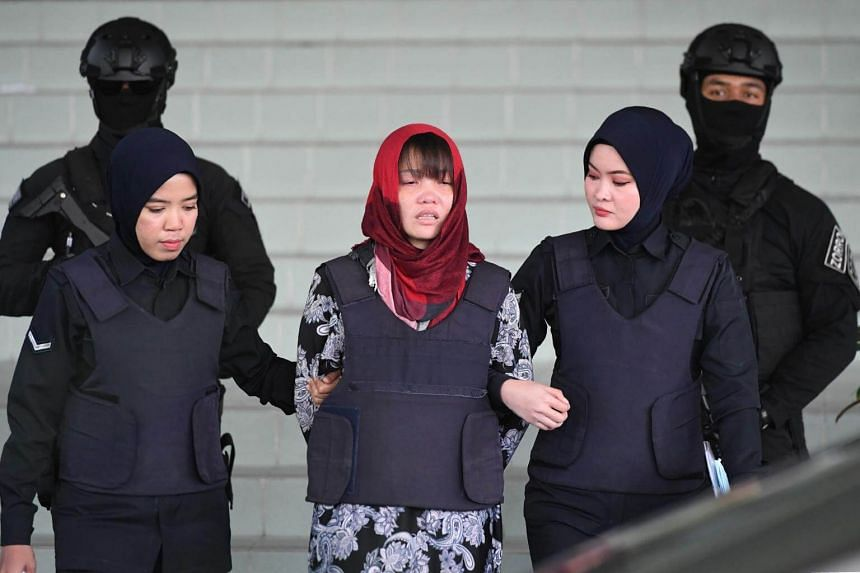 Vietnamese national Doan Thi Huong (centre) leaving Shah Alam High Court, on March 14, 2019.