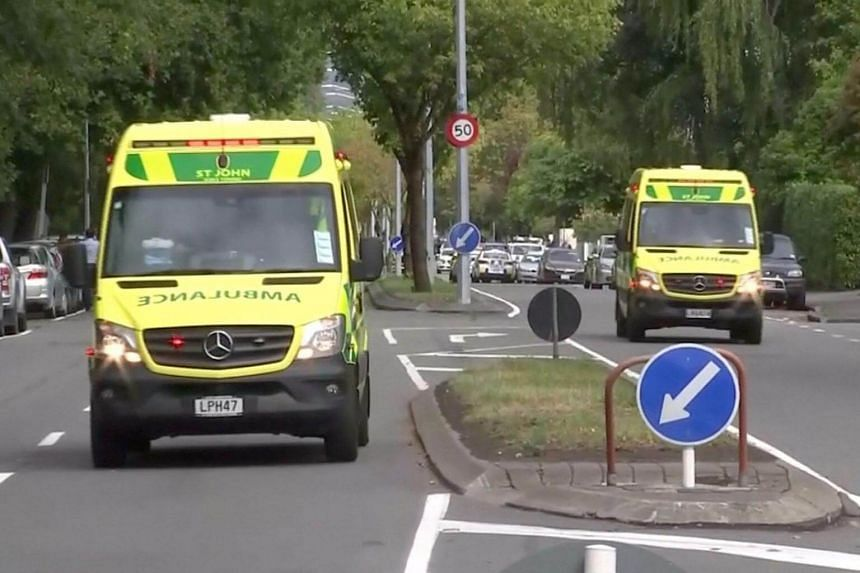 Video screengrab showing ambulances along a street after shootings at at least two mosques in central Christchurch, New Zealand, on March 15, 2019.