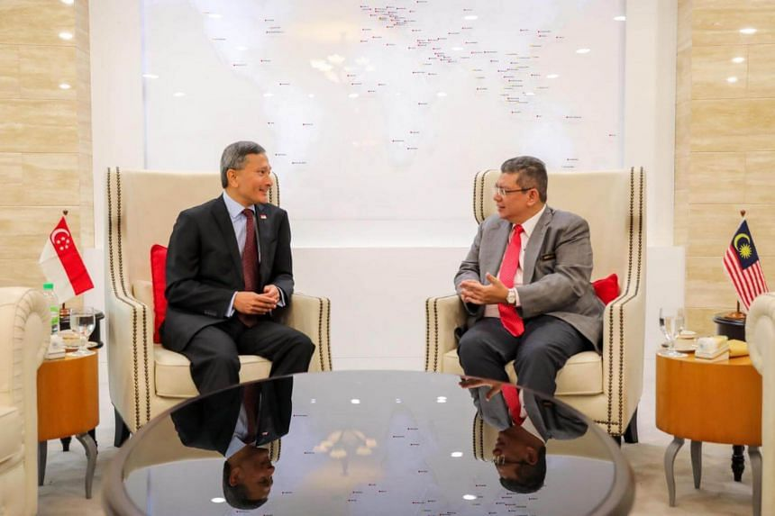 Foreign Minister Vivian Balakrishnan (left) and Malaysian counterpart Saifuddin Abdullah agreed to suspend overlapping claims in Singapore's territorial waters off Tuas.