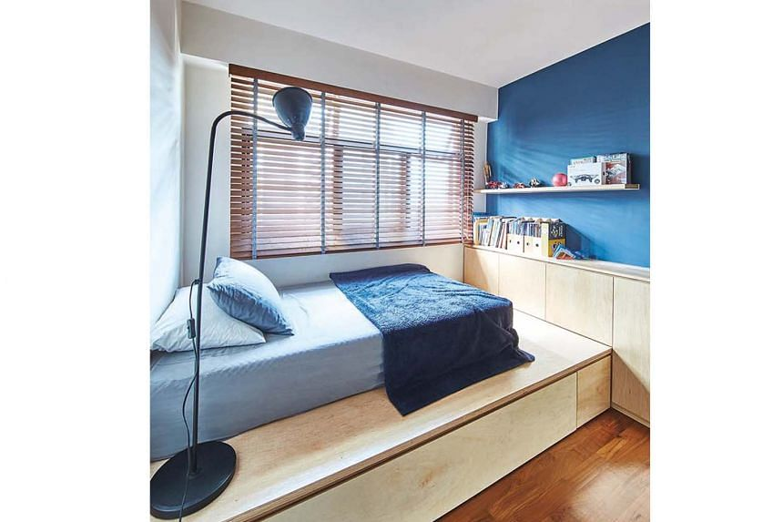Storage under the built-in platform bed helps keep the bedroom clutter-free.