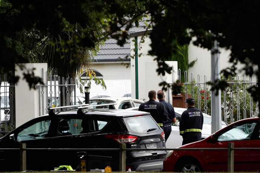 Security officials walk outside Al Noor Mosque after a shooting incident in Christchurch on March 15, 2019.