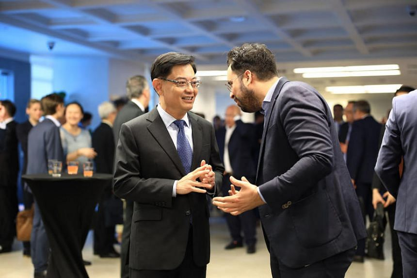 Finance Minister Heng Swee Keat (left) speaking with French Minister of State for the Digital Sector Mounir Mahjoubi, at the closing reception of the Singapore-France Economic Forum.