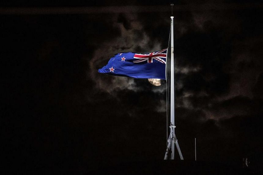 The New Zealand national flag is flown at half-mast on a Parliament building in Wellington, after a shooting incident in Christchurch on March 15, 2019.