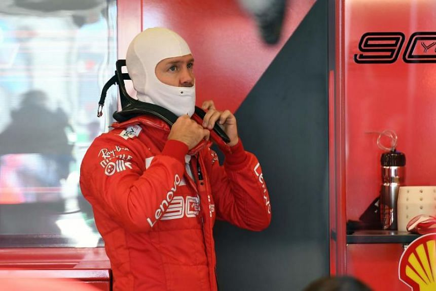 Ferrari's Sebastian Vettel prepares during the first Formula One practice session in Melbourne on March 15, ahead of the Formula One Australian Grand Prix.