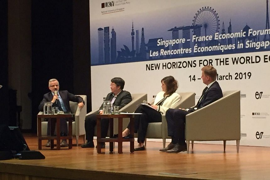(From left) Le Cercle des economistes' Professor Patrice Geoffron; Singapore National Climate Change Secretariat's director for strategic issues Benedict Chia; World Wide Fund for Nature's head of Asia sustainable finance Jeanne Stampe; and Asia-Paci