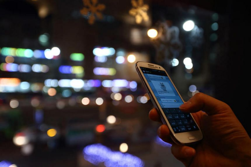 A woman uses the Kakao Talk messaging app in a photograph taken in Seoul, South Korea, on Dec 28, 2013.