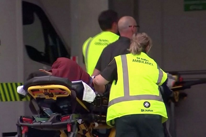 Video screengrab showing emergency services personnel transporting a person on a stretcher at a hospital, after reports that several shots had been fired in central Christchurch, New Zealand, on March 15, 2019.