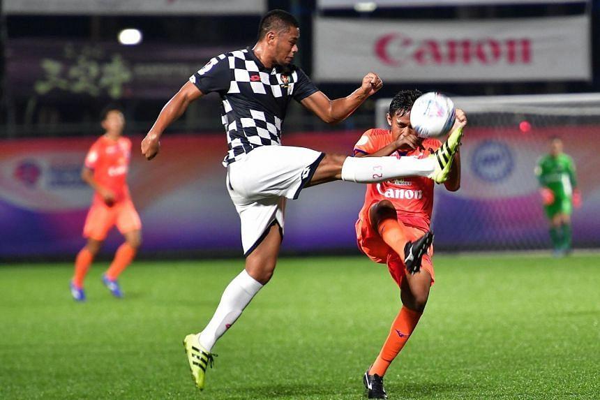 Brunei DPMM's Yura Indera Putera squares off with Albirex Niigata's Zamani Zamri at Jurong East Stadium on March 15, 2019 .
