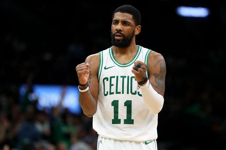 Boston Celtics' Kyrie Irving celebrates during the second half of the game against the Sacramento Kings at TD Garden on March 14, 2019.