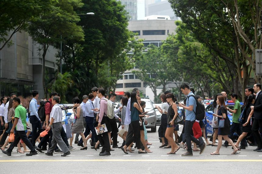 Office workers crossing the road during the lunch hour at Singapore's central business district.