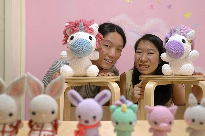Ms Angie Ng (right) runs Tiny Rabbit Hole with her boyfriend, Mr Terrix Lin (left) and ex-colleague Mr Phong Yew Tong.