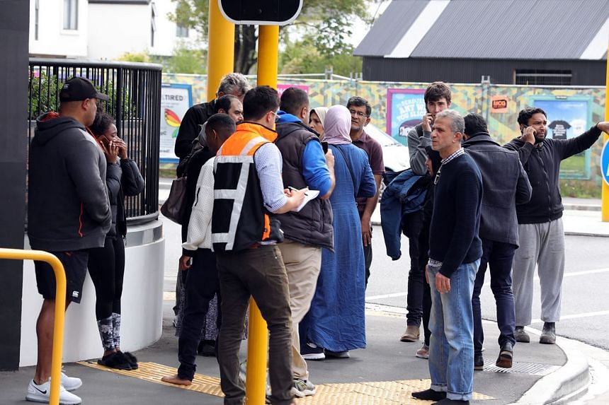 Residents gather near a mosque after the shooting in Christchurch, on March 15, 2019.