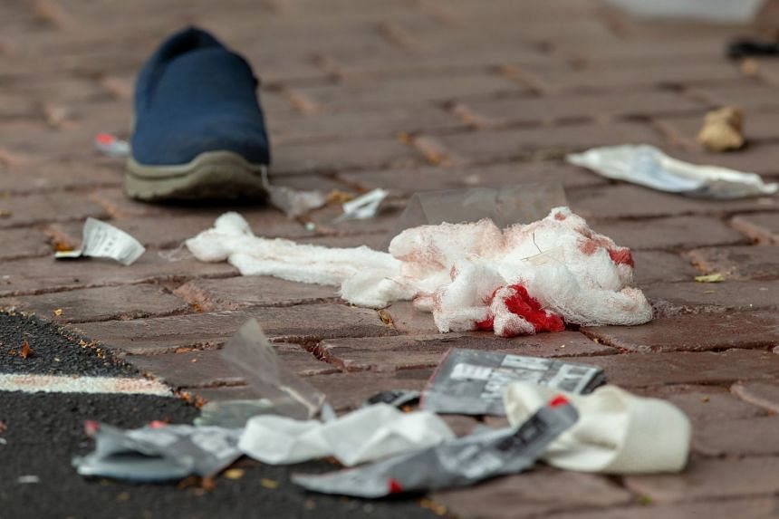 Bloodied bandages on the road following the shooting at Al Noor Mosque in Christchurch, New Zealand, on March 15, 2019.