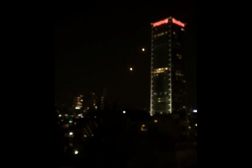 A screenshot of the rockets flying over Tel Aviv from a video posted to social media.