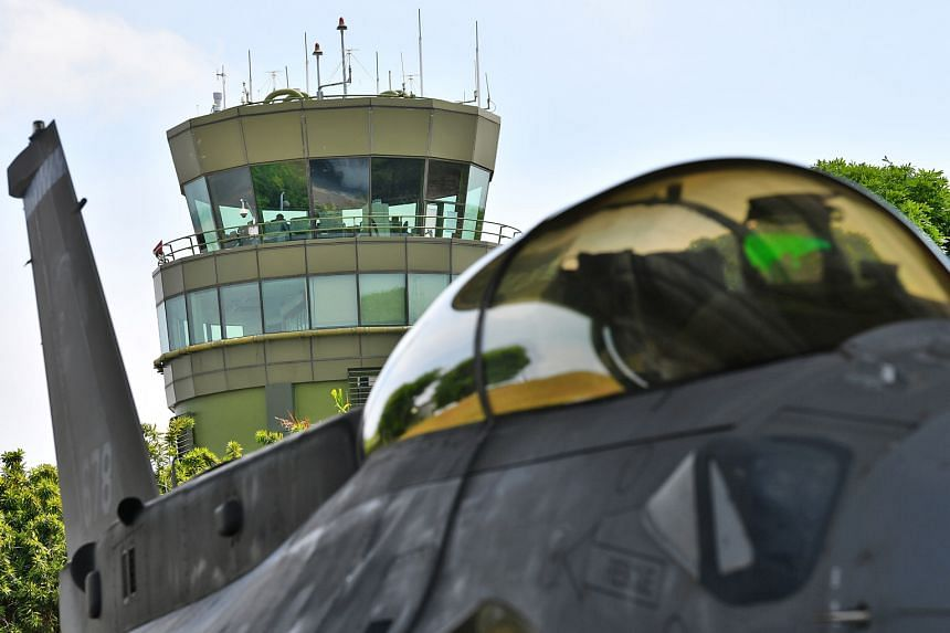 The RSAF air traffic control tower behind an F-16D+ fighter jet at Changi Air Base, where the exercise took place. Two F-16C/D fighter jets closing in on a KC-135 (exercise-simulated civil aircraft) to intercept it and then escort it for landing at C