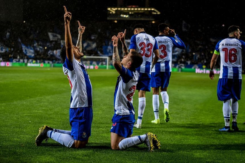 Porto's Brazilian forward Tiquinho Soares (left) celebrates a goal against AS Roma with team mates.