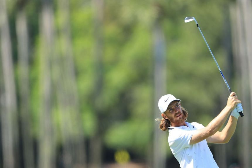 Fleetwood plays his second shot on the ninth hole during the first round.