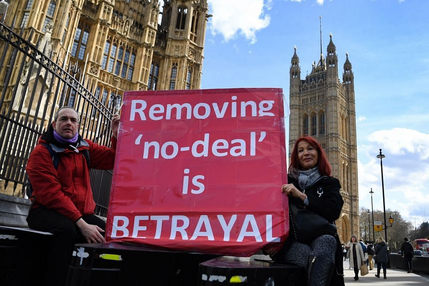 Pro Leave EU protesters campaign outside parliament in London, March 14, 2019