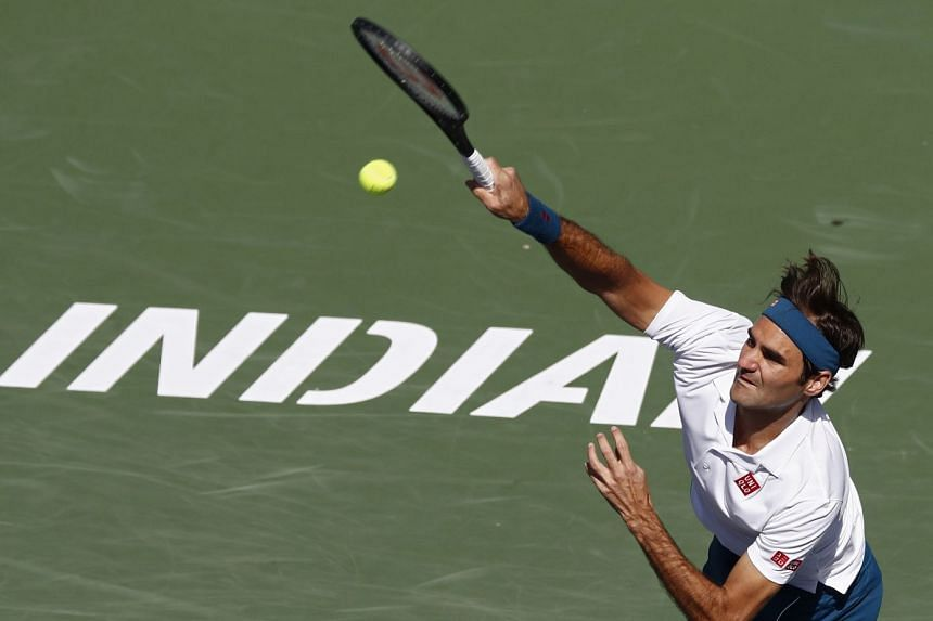 Federer in action against Hubert Hurkacz of Poland.