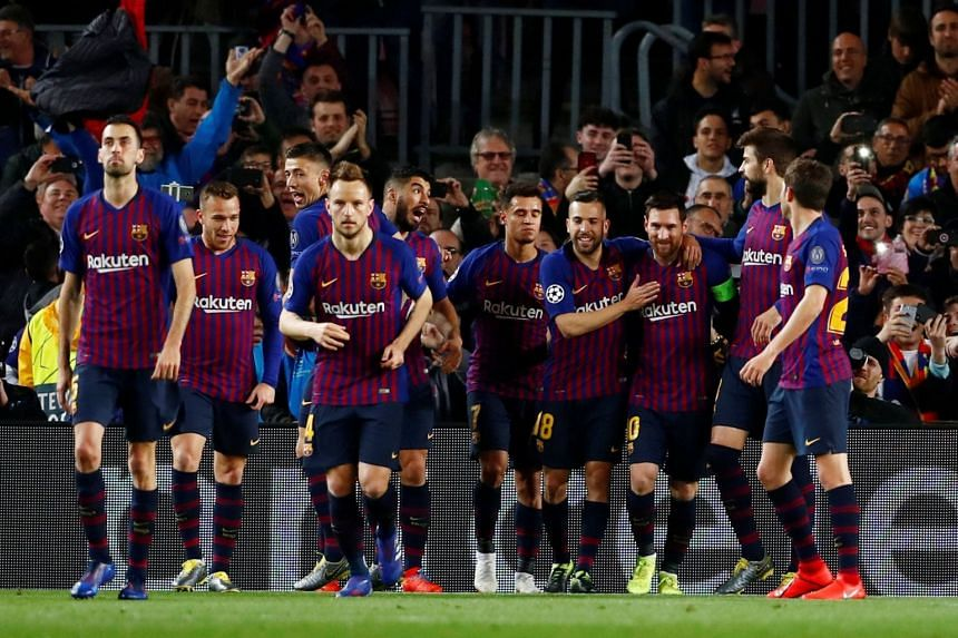 Barcelona's Lionel Messi celebrates scoring their first goal with team mates.
