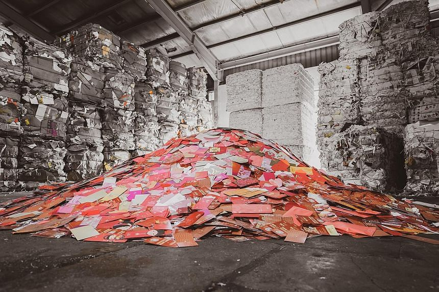 Red packets at Tay Paper Recycling in Gul Avenue. DBS says it has collected nearly 3 tonnes of them, and they will be turned into paper pulp and processed into recycled paper rolls or used to create new paper products.