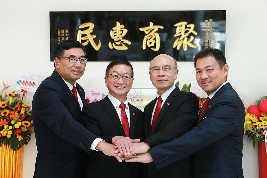 SCCCI president Roland Ng (second from left) with vice-presidents (from left) Mr Kuah Boon Wee, Mr Charles Ho Nai Chuen and Mr Pek Lian Guan. The chamber installed its 60th council yesterday, marking the start of Mr Ng's second term as president. His
