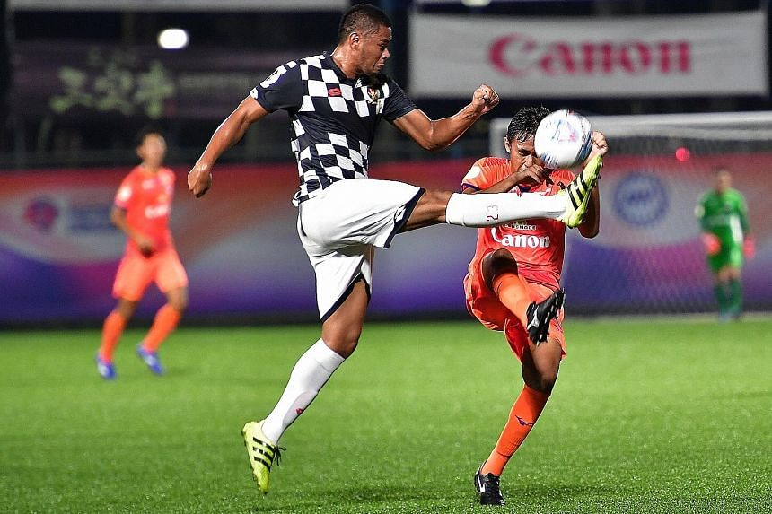 Brunei DPMM's Yura Indera Putera (left) and Albirex Niigata's Zamani Zamri tussling for the ball at Jurong East Stadium last night. The teams drew 0-0.