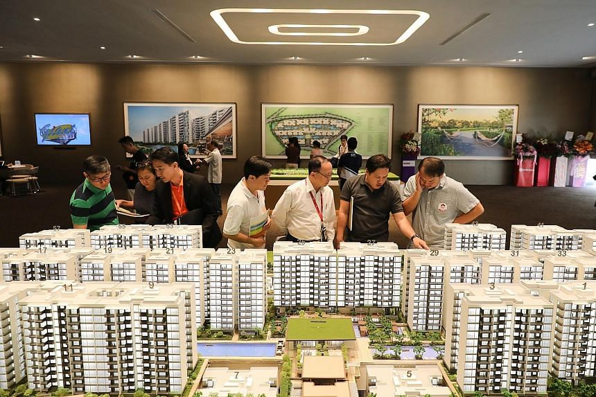 Visitors at the preview launch of Treasure At Tampines yesterday. The site in Tampines Street 11 spans about 650,000 sq ft - or about 11 football fields - and offers one-to five-bedroom apartments that range in size from 463 sq ft to 1,722 sq ft.