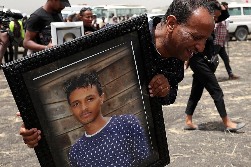 MR YARED GETACHEW (whose portrait is carried by a mourning relative).