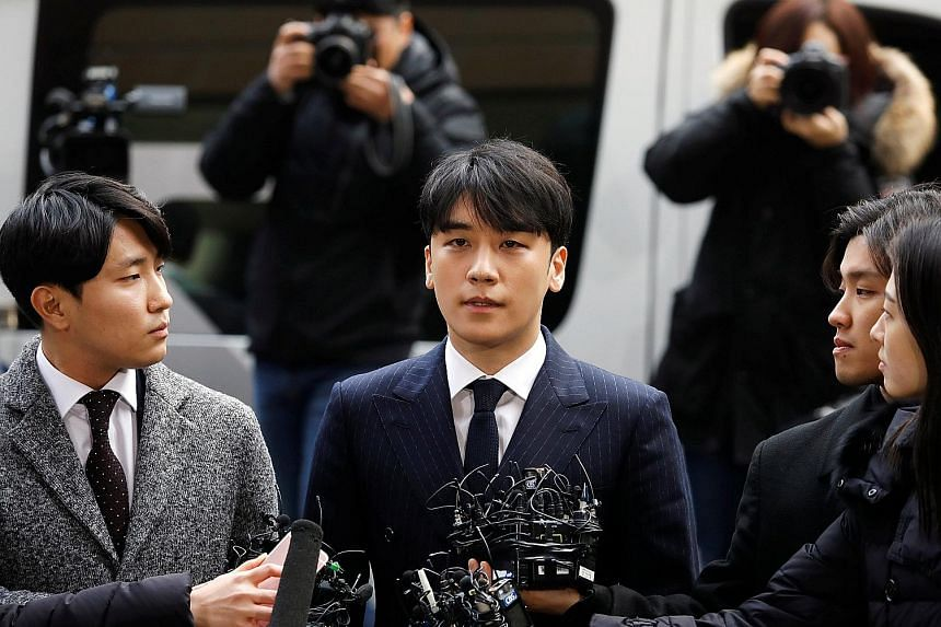 Seungri (centre) arriving at the Metropolitan Police Agency in Seoul, South Korea, on Thursday for questioning.