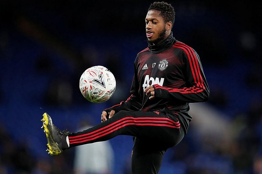 Fred warming up before United's FA Cup fifth-round win over holders Chelsea at Stamford Bridge last month. He was an unused substitute and will be hoping to feature in today's quarter-final away to Wolves.