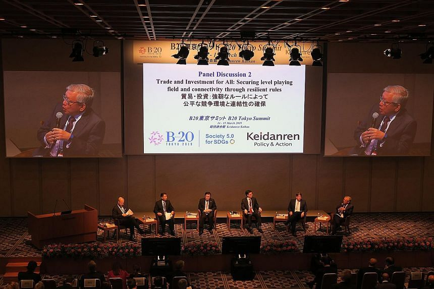 Singapore Business Federation chief executive Ho Meng Kit (right) speaking during a panel discussion on trade and investment at the Business 20 summit in Tokyo yesterday. The other panellists are (from left) Mr John Denton Ao, secretary-general, Inte