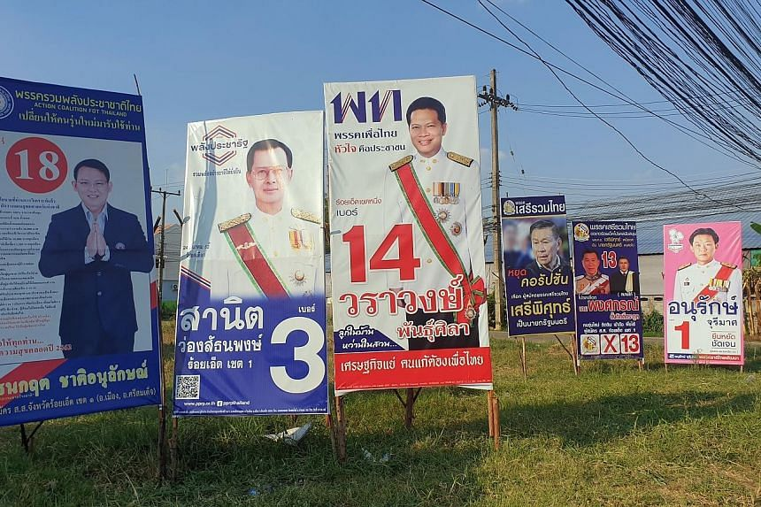 Election posters in Roi Et province, north-east Thailand. Some rural folk in the north and north-east - Pheu Thai Party's strongholds - continue to keep their faith in fugitive former prime minister Thaksin Shinawatra.