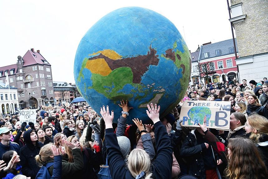 Students from countries all over the world, such as (from left) Australia, Sweden and South Koreajoining the Global Climate Strike yesterday to pressure world leaders into action on climate change.