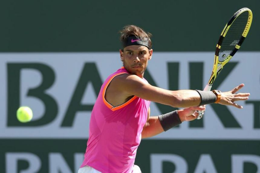 Rafael Nadal of Spain returns a shot to Karen Khachanov of Russia during the quarterfinals of the BNP Paribas Open at the Indian Wells Tennis Garden in Indian Wells, California on March 15, 2019.