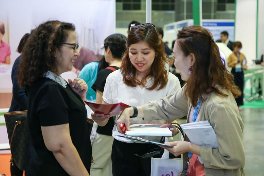 Job seekers of all ages streamed into the event's venue at Suntec Singapore Convention and Exhibition Centre to meet with various employers and experienced training providers present.