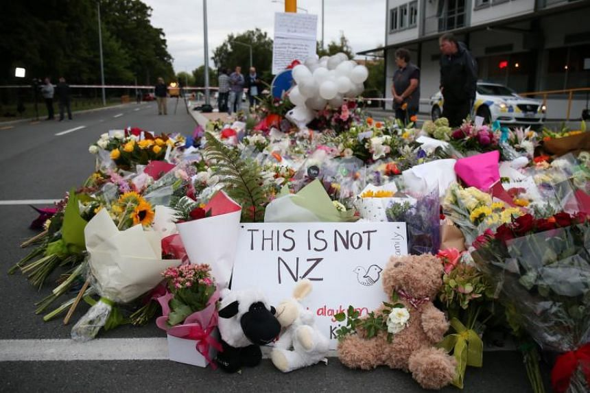 Floral tributes are seen at a makeshift memorial for victims of the March 15 mosque attacks, in Christchurch on March 16, 2019.