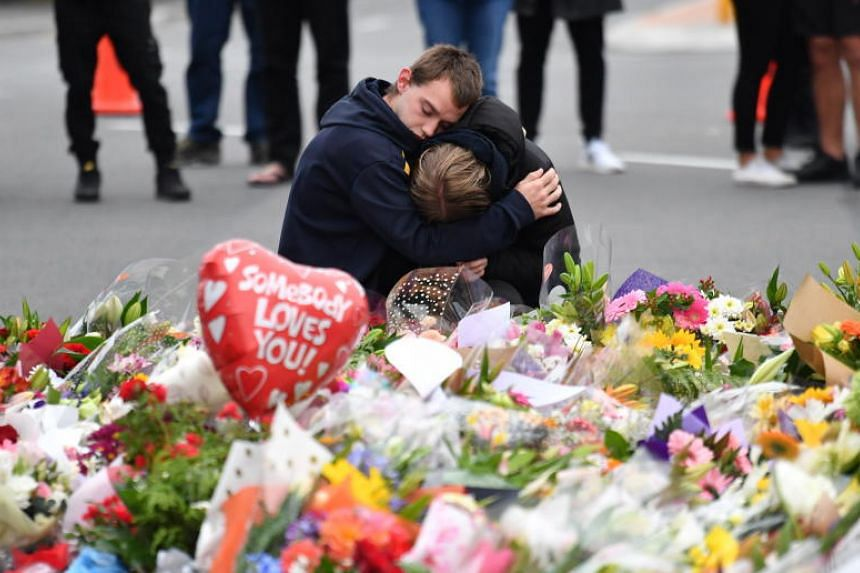 Members of the public mourn at a flower memorial near the Al Noor Masjid on Deans Rd in Christchurch, New Zealand, on March 16, 2019.