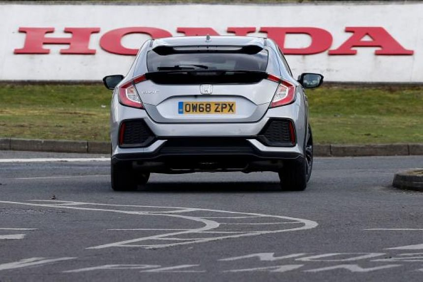 A Honda Civic car is driven at the Honda manufacturing plant in Swindon, southwest England on Feb 19, 2019.