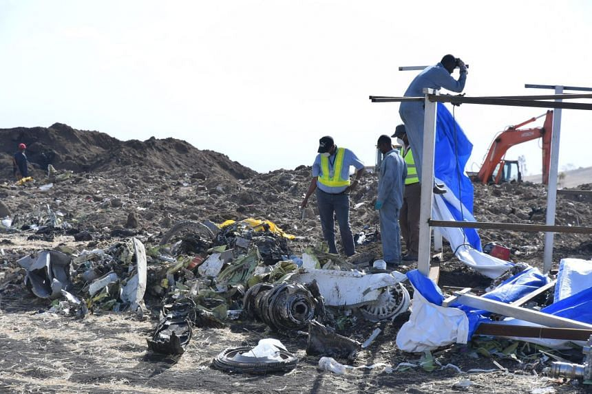 Rescue workers search the site for pieces of the wreckage of an Ethiopia Airlines Boeing 737 Max 8 aircraft near Bishoftu, Ethiopia on March 13, 2019.