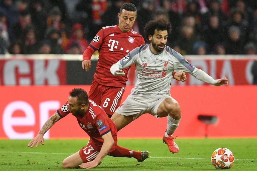 Liverpool's Egyptian midfielder Mohamed Salah (right) and Bayern Munich's Brazilian defender Rafinha (left) vie for the ball during the Uefa Champions League, last 16, second leg football match Bayern Munich v Liverpool, on March 13, 2019.