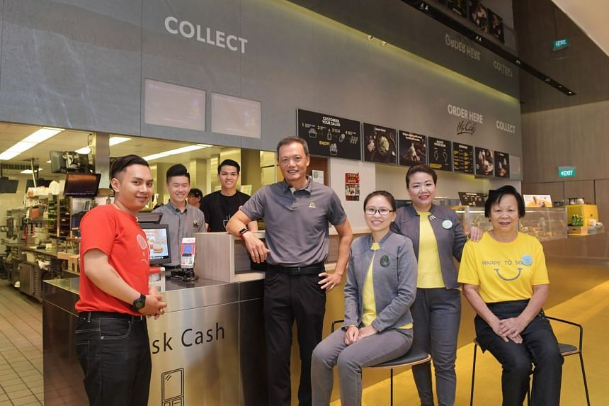 Mr Kenneth Chan, managing director of McDonald's Singapore (fourth from left) with his Marine Cove team. From left: Crew leader Muhammad Fahmi Jamsari, second assistant manager Anthony Lim, barista leader Hafiz Mohamed, guest experience leaders Miche